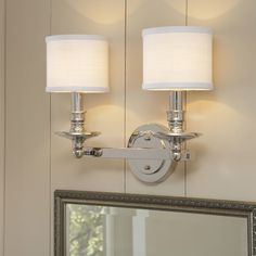This two-fixture design offers ample light in a style that incorporates traditional turned details and decorative white shades. Traditional and stylish, the Birch Lane Hollister 2 Light Bath Vanity Light can illuminate your bathroom with great ease. The frame of the vanity light has a candelabra inspired design. It has two cylindrical shaped shades that have an upward light direction, which evenly lights up the ambiance. The Hollister 2 Light Vanity Light from Birch Lane is made from steel…
