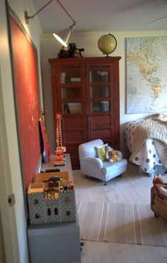 son's bedroom:  love the map (my son's bedroom is covered in map wallpaper on all four walls w/a blue ceiling); love the armoire, love the red chalkboard paint; sconce (Boston Library light - Circa Lighting)