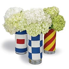 Nautical. Use left over floral vases; wrap in fabric or flags; secure with hot glue