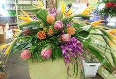 Casket flowers with tropicals