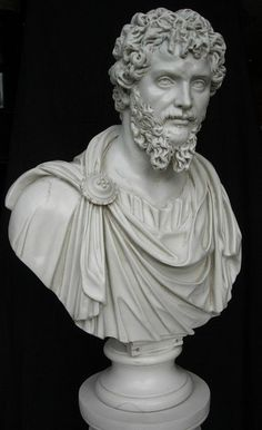 SEPTIMIUS SEVERUS - A marble bust, with toga drapery.