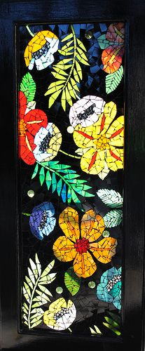 Glass cabinet door turned into a mosaic stained glass tropical flower garden.