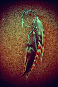 Grizzly Feather Cross Chain Ear Cuff on Etsy