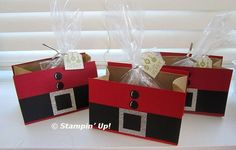 """Kari brought these Santa treats to share at Club the other night. She cut the paper bags shorter and added fronts and back covers out of Real Red or Cherry Cobbler card stock making them as wide as the front of the bags. Details: The black strips are 1 1/2"""" high. The glittery squares are made from our fabulous Silver Glimmer card stock and are 1 1/2"""" square. The black 1""""squares in the center are another layer over the Silver..."""