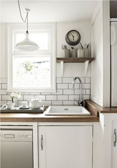 white kitchen. Love the subway tile and the light fixture! wood tops & the open shelving.