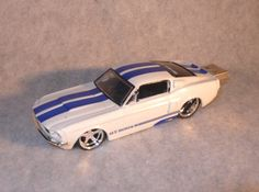 4GB USB 67 Shelby GT500KR Flash Drive. 1:64 scale collectible 1967 Ford Mustang GT500KR. Fitted with a full functioning 4GB Flash Drive, USB 2.0. Hundreds of moderate resolution images can be safely stored. Included with the car is a USB 2.0 extension cable. This is a fine quality modified and hand crafted gift that will bring years of service and interesting conversation. Price: $25.00. SEE FULL COLLECTION OF DIE-CAST CAR FLASH-DRIVES: http://www.etsy.com/shop/DHHdesign?section_id=6432253