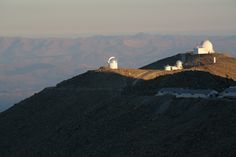 Swope, du Pont and OGLE telescopes at Las Campanas Observatory in Atacama, Chile. LCO is owned by the Carnegie Institution for Science, and is operated by the Carnegie Observatories. Photo by Matias del Campo