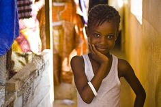 A child in Freetown, Sierra Leone, models our ONE band. Photo credit: Morgana Wingard/ONE