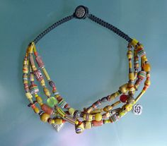 by Kathleen McCabe-Elsey ~ Don'Kay Designs | Strand mix of  Antique Venetian, Bohemian and African glass beads, contemporary pewter charms.  Macrame finish  | 598$
