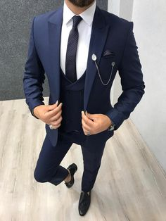 Collection: Spring – Summer 2019 Product: Slim-Fit Wool Suit Color Code: Navy Blue Size: Suit Material: wool, polyester Machine Washable: No Fitting: Slim-fit Package Include: Jacket, Vest, Pants Only Gifts: Shirt, Chain and Neck Tie Navy Slim Fit Suit, Black Suit Men, Navy Blue Suit, Men's Blue Suits, Mens Slim Fit Suits, Navy Blue Tuxedos, Mens 3 Piece Suits, Look Formal, Men Formal