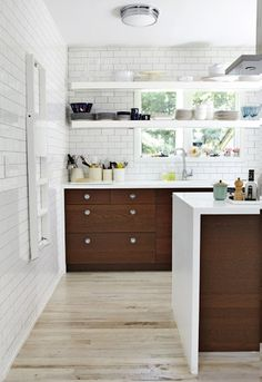 Kitchens: contrast of white and rich brown, white floor to ceiling subway tiles, open shelves, island