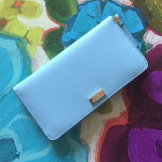 "Light blue Kate spade wallet NWT Kate spade neda wallet Newbury lane. Color is blehydrnga. 8"" x 4"". Price is firm! Let me know if you have questions! kate spade Bags Wallets"
