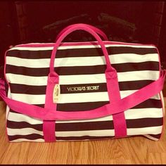 Victoria's Secret duffel bag Black & pink striped Victoria's Secret duffel bag with silver hardware. Can be used to hit the gym or carry on for vacation.✈️ Victoria's Secret Bags Travel Bags