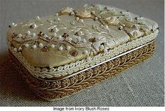 This is an Altoid tin. No, really! Lisa of Ivory Blush Roses beautifies everything she touches, including household debris such as old CDs and Altoid tins. Go see.