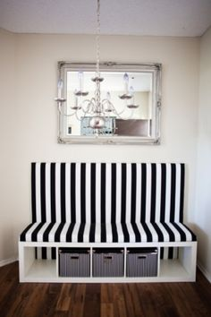 IKEA Hackers | Expedit Turned Banquette Seat: A bookshelf turned sideways and given an upholstered backing becomes a chic storage bench.