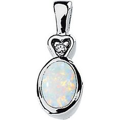 Genuine Opal Cabochon & Diamond Pendant.  Call Martin Jewelry at Westroads Mall in Omaha, NE. for more details.  402-397-3771.