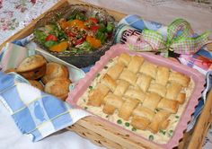 Gift box of chicken pot pie, muffins, salad & book for sick friend.   This is very similar to what I usually make to take.  I do a strawberry salad and include a dessert.  Often, I will also make macaroni and cheese. Kids usually like that and I send enough food for a couple of meals, at least.  :)