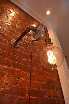Pulley Light - Wall Light - Industrial Lighting - Lighting - Wall lighting - Industrial light - Bar Light - Pub Light - Steampunk Light by WestNinthVintage on Etsy https://www.etsy.com/listing/193066665/pulley-light-wall-light-industrial