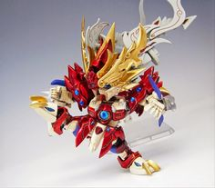 "MODELER: Pura Pura MODEL TITLE: Ashura Gundam ""紅の阿修羅神 孟節ガンダム"" MODIFICATION TYPE: kit bash, custom color scheme, scratch built parts KIT..."