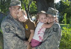 Master Sgt. Rodolfo Gamez and his wife, Tech. Sgt. Christina Gamez, hold their children, Tomas, 4, and Eva, 3, for a portrait outside of their home. The Gamezes are set to deploy to two different locations for year-long deployments later this year.... God Bless you both & your beautiful family. Thank you for your services & your sacrifices‼