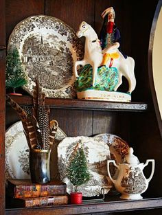 Pieces of vintage brown transferware collection stand next to a Staffordshire horse in an 18th-century English hutch. Collected feathers stand in for flowers in an old horn cup. More photos from this home: http://www.midwestliving.com/homes/featured-homes/house-tour-deck-the-stalls/page/11/0