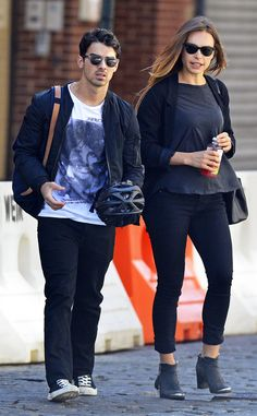 Joe Jonas, in hip shades with mirrored lenses, takes a stroll through NYC with his gal pal Blanda! We dig her demure cat-eyes too!