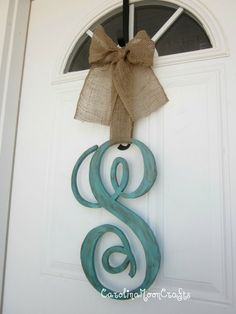 Big wooden letter  paint  ribbon...so easy!