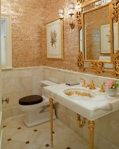 traditional powder room by david phillips- marble on the lower walls & the sink