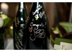 Wine bottle guest book idea:  Have 12 bottles of wine for guests to sign, each one representing a month during your first year of marriage.  Open one bottle a month & enjoy the memories! #DBBridalstyle