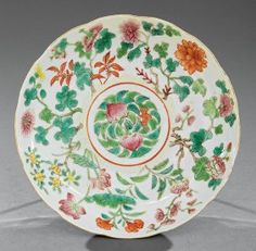 Chinese Famille Rose Porcelain Dish, probably 19th c., decorated with a central peach medallion surrounded by flowering plants, base with Daoguang mark, h. 1 1/4 in., dia. 7 1/4 in