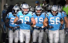Carolina Panthers middle linebacker Luke Kuechly (59) leads the linebackers out…