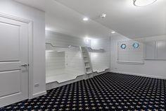 Large 4 bed nautical themed bunkroom in this huge finished basement. Visit to see the complete custom home tour. . #interiordesign #bedrooms #bunkroom #designideas #homechanneltv #homechannel