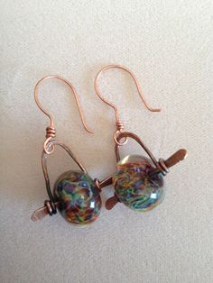 Check out this item in my Etsy shop https://www.etsy.com/listing/171182701/hand-forged-copper-earrings-with