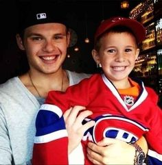 Montreal's Alex Galchenyuk and this delighted little fan in his way-too-big jersey.