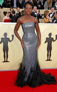 Lupita Nyong'o from Standout Style Moments at SAG Awards 2018  Va-va-voom! Thank you, Lupita, for bring drama to the red carpet with this metallic Ralph & Russo creation, topped with a gorgeous, feathery overlay.