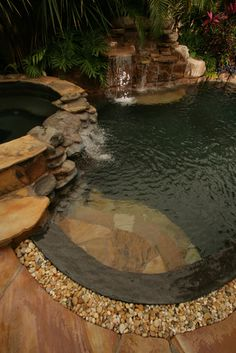 I love the natural look of this pool with the rock portion of the fountain. Beautiful.