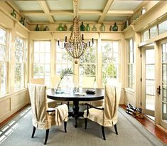 light sage green paint in the coffered ceiling. such a beautiful way to accent the trim