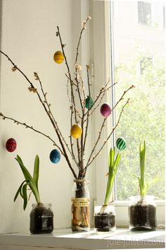 easter decoration: branches decorated with DIY easter eggs