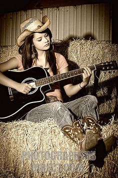 Image detail for -Pretty cowgirl playing guitar in a barn stock photo