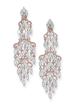 If these were white gold and not rose gold, they'd be on the Jewelry board. Chandelier diamond earrings by Youssofian