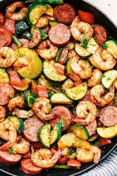 CAJUN SHRIMP AND SAUSAGE VEGETABLE SKILLET. 52 Easy Summer Seafood Recipes You Can Whip Up in 20 Minutes #purewow #recipe #food #dinner #cooking #summer #seafood #easy #skilletmeals #skilletdinners #seafoodrecipes #fishrecipes #shrimp