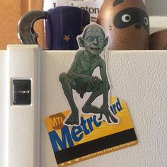 Gollum Lord of the Rings Fridge Magnet ($6) ❤ liked on Polyvore featuring home, home decor, office accessories, grey, home & living, kitchen & dining, kitchen décor, refrigerator magnets, magnet stickers and magnets refrigerator