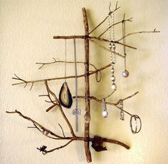 DIY Branch Jewelry Display (Design Crush) - I'd like to try something similar with wire, maybe twist the wire so it's like a spiral for the center pieces and branch out thinner wire that's not so tightly wound from there.  This might also look really pretty with silver branches.