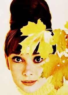 Audrey Hepburn wearing a yellow tricot sweater by Balmain, New York, June 1963. Photo by Howell Conant.