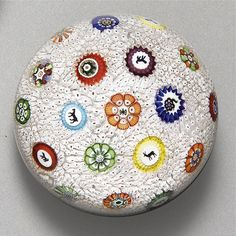 A BACCARAT SIGNED AND DATED SCATTERED MILLEFIORI WHITE STARDUST CARPET GROUND WEIGHT<br>19TH CENTURY | Lot | Sotheby's $7,500.00