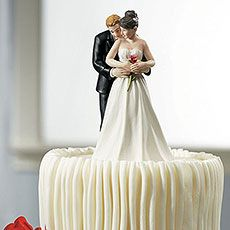 This lovestruck Groom is sure to never let go of his beautiful Bride. The elegant detailing on the Bride's hair and gown, coupled with just the right touch of colour on the rose will add romance to any Wedding Cake. Hand painted porcelain.
