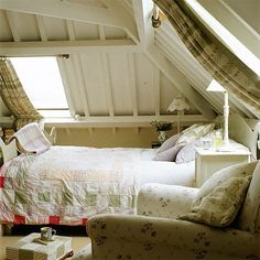 Loft bedroom - note how they handled the drapes in the skylights - I'll try this and maybe can finally block more light