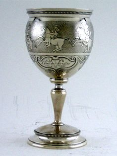 An American Coin silver goblet, parcel gilt, maker's mark of Albert Coles, New York, Circa 1865. Urn-shaped, applied with beaded borders, engraved with classical warriors against a stippled ground, engraved A.M. To A. Gundersheimer/Aug 23rd 1865; Height is 7 inches, Weight is 7.25 Troy ounces