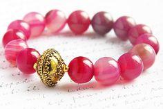 Carnation Pink Agate Bracelet. Fancy Gold Bali Bead. Stacking Statement Bracelet. Bright Colorful Feminine Round Gemstone KapKaDesign. $59.00, via Etsy.