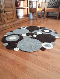 REDUCED PRICE: Original price was $140..00 Reduced price is $110.00 This area rug is made up of many circles that were sewn together. The fiber of this rug is UN-dyed wool. Cream, oatmeal grey, and dark brown. I have added a non-slip mat to the larger circles. This will keep your rug where you place it. Nothing worse than a rug slipping out from under you. My son tested the gripping factor and it held up rather well with his running around. Size: measured at the widest. 2 feet, 10 inc...